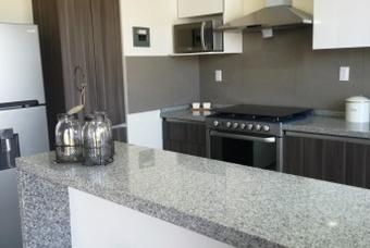 Cocina Integral de casa modelo Ibiza en Calimaya de Villas del campo